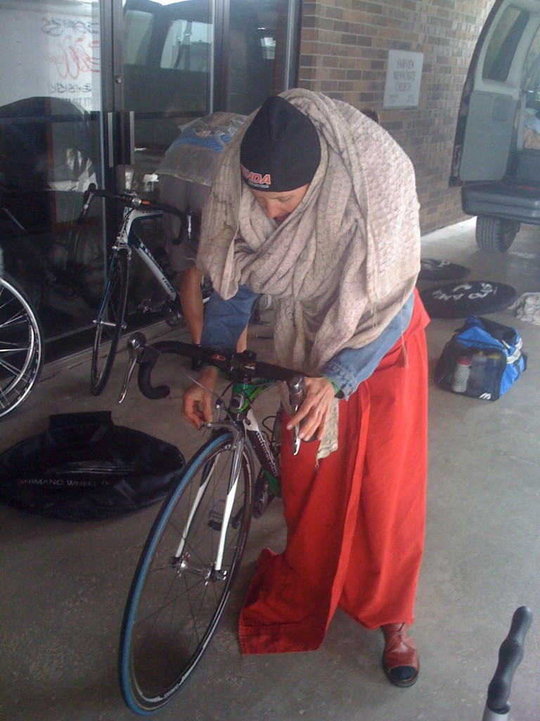 """Bag Lady"" Catherine trying to stay warm before the race with bike blankets."