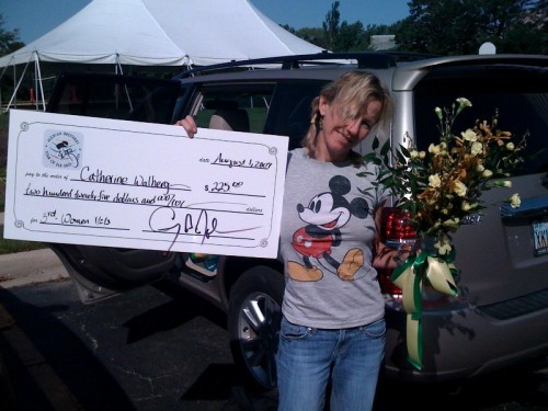 Nicer photo of Catherine with her big size check.