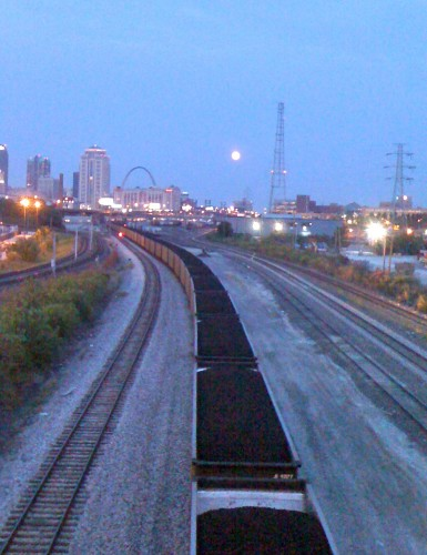 Dusk riding to the race.  Full moon over the tracks.  St. Louis arch in the background.