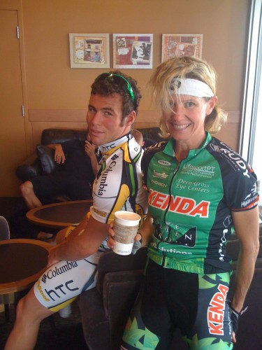 Catherine with Mark Cavendish at Starbucks before the race.  She told him he would win for sure.  Who is bigger?