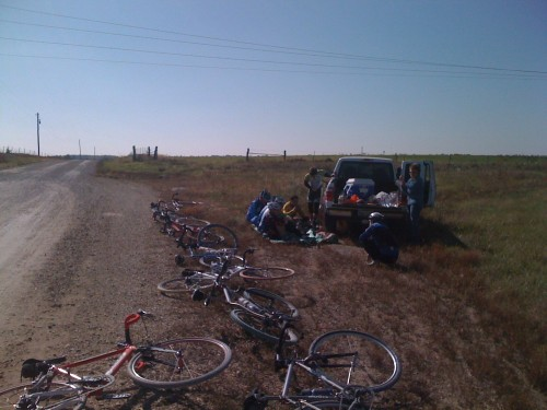 What is left of the group huddling at the lunch stop at 60 miles.  It's not the temperature, it's the wind that gets you.