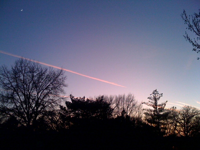 Sunsets in Kansas are 2nd to none. I counted 19 contrails in the sky when I took this photo.