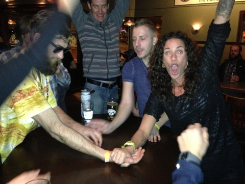 Arm wrestling at the after race party.