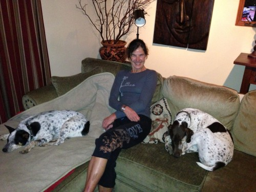 Sue sitting with her two babies, Kya and Ranger.  Between the two of them, they have two eyes.  They are both survivors.
