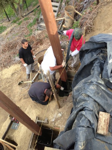 I was woken every morning to these guys who are putting up a new retaining wall in the back.  I was itching to help them.