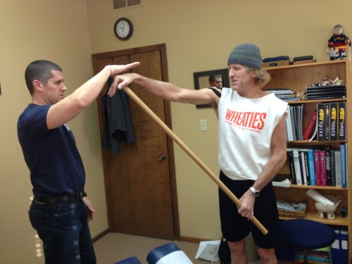 Trying to get stop my muscles from locking up with Rob Jones.