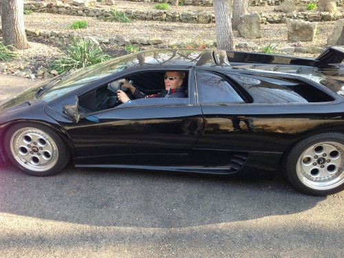 This is Dennis about ready to take Vincen'ts dad's Lamborghini Diablo out for a spin.  You need a very strong left leg if you're going to drive this car, the clutch is killer.