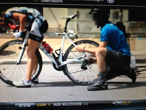 The guy is still trying to put the wheel in with the derailleur in his hand.