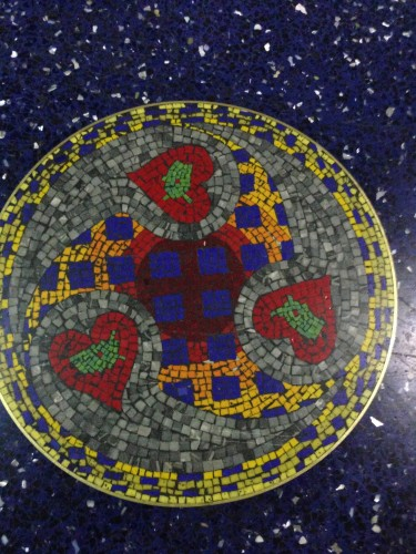 The floor at the Kansas City airport is a terrazzo floor.  It is pretty cool.  I wonder why more people don't use this for home flooring?  Probably the cost.