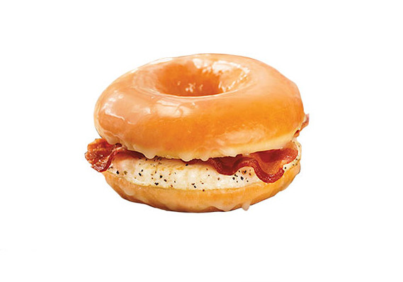 I saw that Dunkin Donuts is making a breakfast sandwich with an egg, bacon, layered by a donut.  I wouldn't be adverse to eating this.  They say it only has 360 calories, less than a blueberry muffin they sell.  Weird.