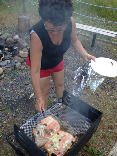 Stacie grilling salmon for dinner.