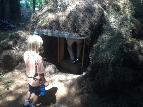 And his child watching Catherine go into a hay hut he built.