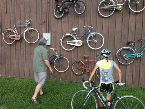 Fatman, Gary Crandall, showing Catherine his old bike collection.