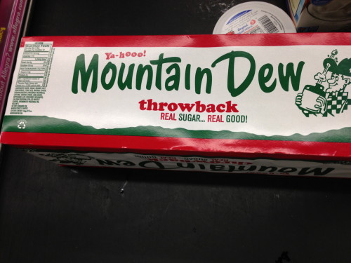 The guy in front of me shopping had this Mt. Dew.  It doesn't have any corn syrup.  It is made with sugar.  I don't know how much it cost, but he said that it wasn't nearly as sweet as normal Mt. Dew.