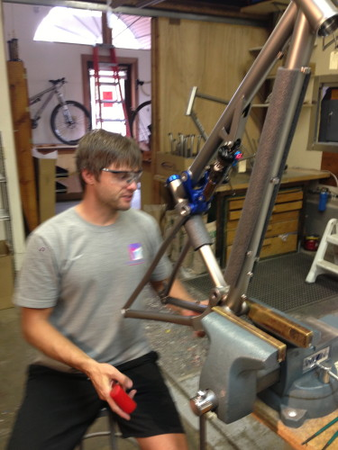 Brad Bingham assembling one of his dual suspension bikes.