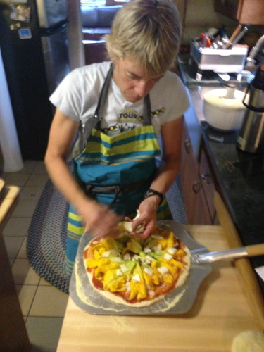 And once again, Katie creating.  This is a squash blossom pizza.  The only other time I have had squash blossom was in San Diego.  They were fried.  I very much doubt I would eat them raw.  I must be a Colorado/California thing.