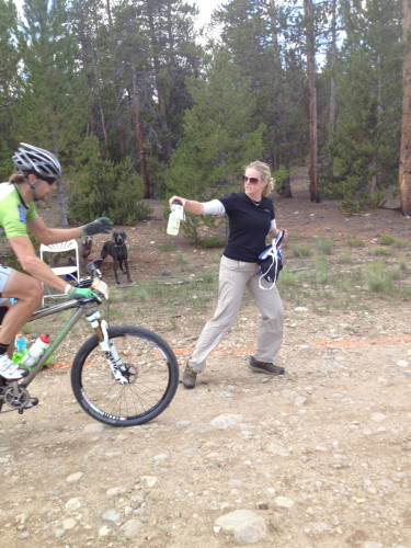 Michelle, Brian's wife, feeding him at the last feed zone yesterday.
