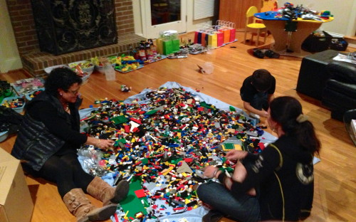 "Trudi, Stacie and her son Adam sorting through ""a few"" legos for Adam's birthday party this weekend."