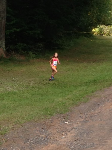 This little girl was haulin' on the 5 km.