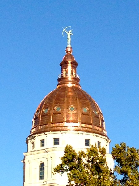 They just finished putting a new copper dome on the Capitol.  The last one was leaking, I guess.  It will eventually turn green, but maybe not for decades.