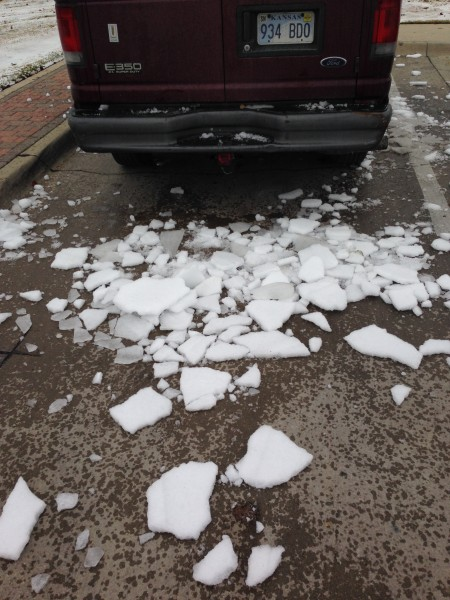 I knocked this off the roof of my van at Love Field in Dallas.  I was worried about the ice launching off into the windshield of a following car or truck.