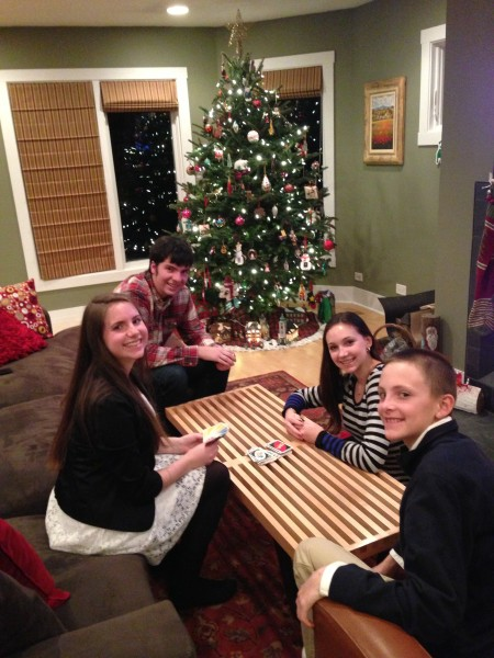 Her nieces and nephews.  Hannah, Parker, Madeline and Alec.  At the kid's table.  Seems like they might have out grown it.