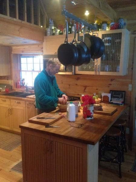 "Dennis starting his ""famous"" pancakes."