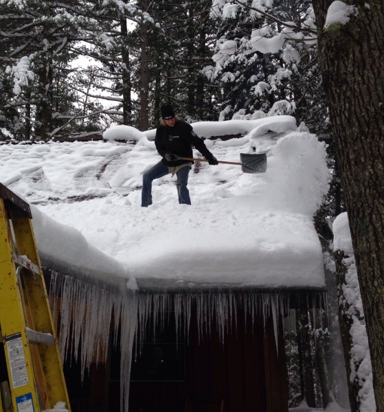 The snow is pretty deep on the roof.
