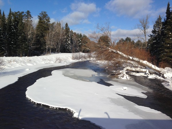 The Namekagon river is still flowing with a week or temperatures way below zero.