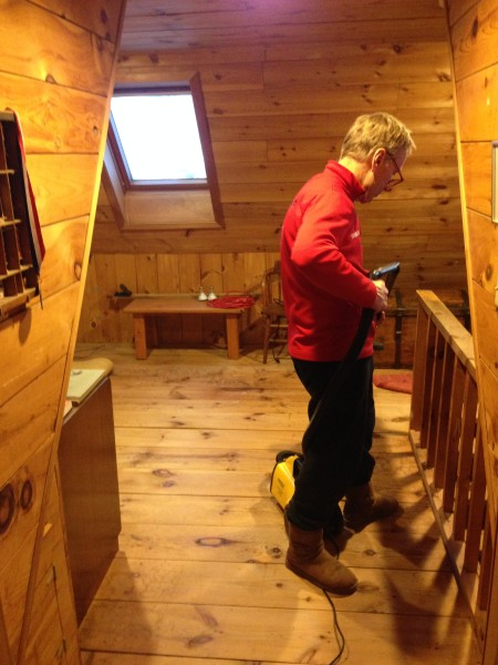 Dennis cleaning up the loft after installing new cannister lights.