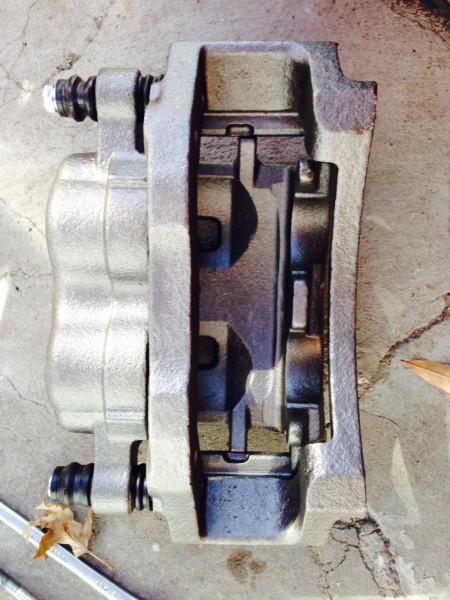 New/rebuilt caliper.