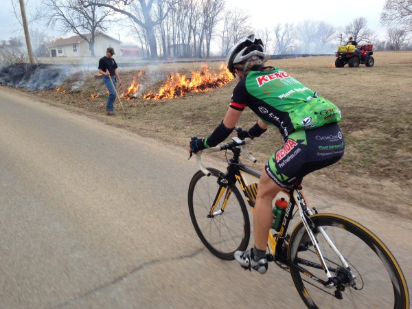 Catherine riding back from the race last weekend and the guy just burning because he can, not for the real reason for burning.