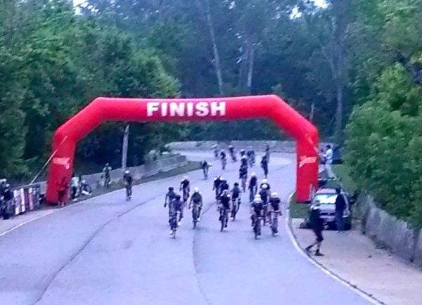 FInish sprint photo.  The line was 10 feet before the banner.  I'm in the middle about 5th, in the white helmet.