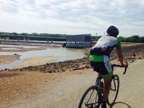 Brian riding into Lawrence on the levee.   They are building a new hydro electrical plant there now.
