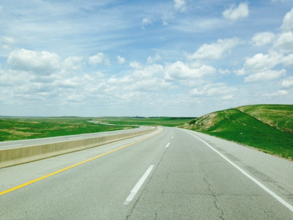 The grass on both sides of the road in the Flint Hills is pretty green.