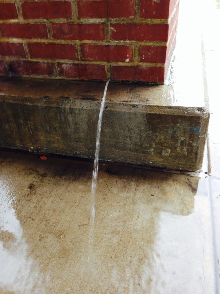 Water was pouring out of a pillar at a local shopping mall.  I have no idea what the problem is to have this brick column full of water, but something is really wrong.