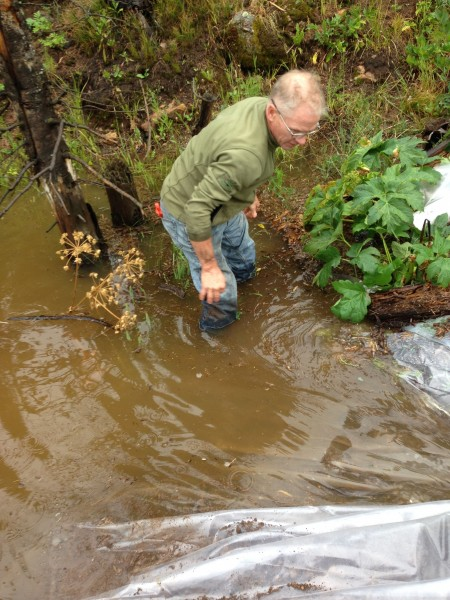 Kent doing a temporary fix, lining our spillway with plastic.