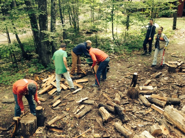 Splitting wood is a communal project after the Fat Tire.