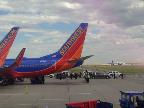 There were doing some sort of color guard funeral at the Denver airport.