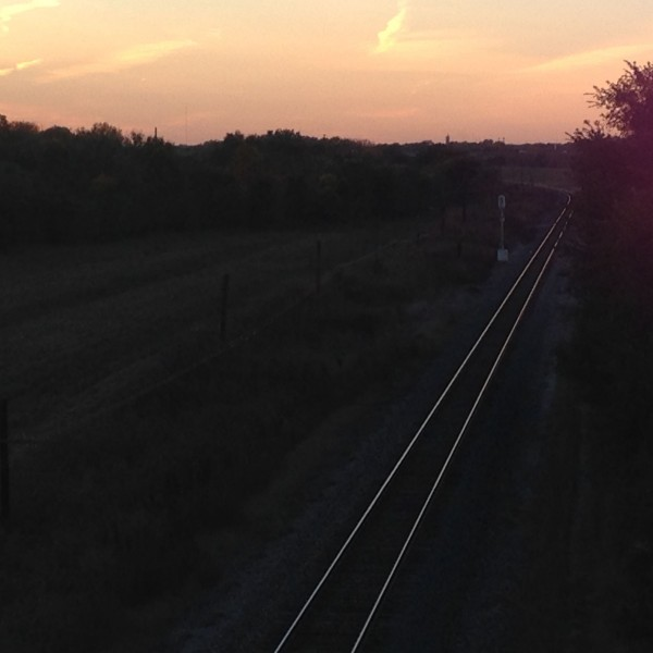 I like to take picture of train tracks at sunset.