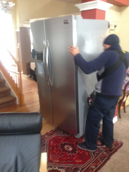 They got a new refrigerator this morning.  The moving guys just used a strap over their shoulders to move the old one out and new one back in.  Pretty cool.