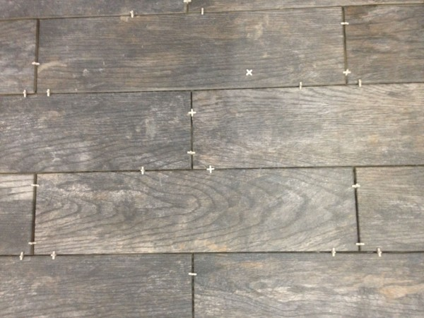 I don't use tile spacers so much on floors, but Vincent wanted super thin grout lines and it would be easy to get off pattern with each of us working sort of indepently.
