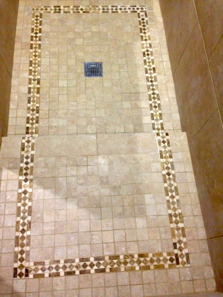 The accent trim on the floor was sort of a hassle since it wasn't the same width as the mosaic tiles.