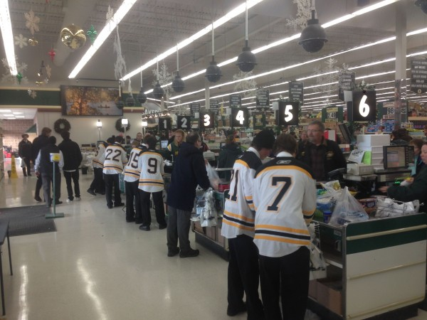 The highschool hockey team was bagging groceries at the local grocery store in Hayward last night.