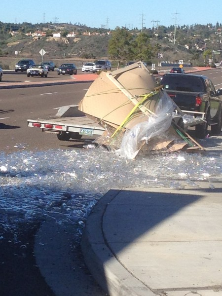 We saw this truck on La Costa dump over a load of bottles.  It happened in slow motion.