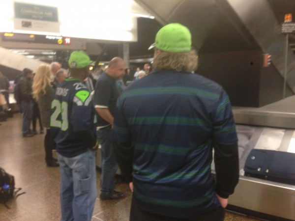 Waiting for luggage last night, everyone is dressed in Seahawk colors.