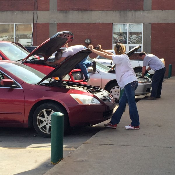 Funny how many people fix their cars in the autopart store's parking lot.  I've done it myself.