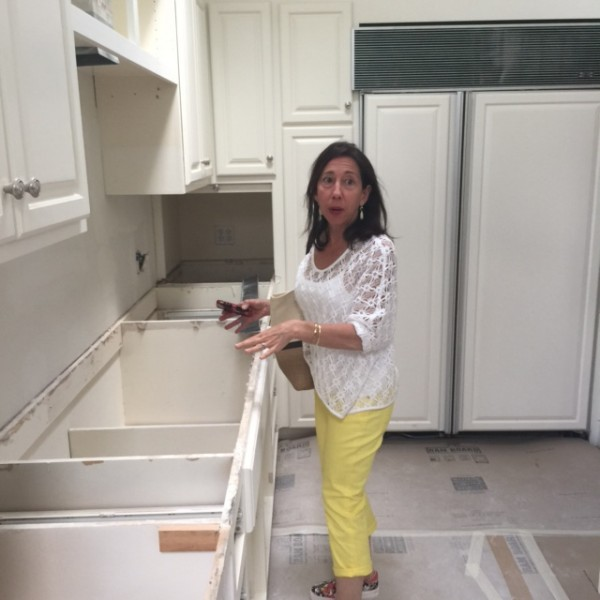 Ann showing me the kitchen in their new house.