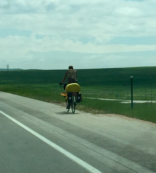 This guy was riding down I-70 outside of Limon, CO.  I saw another cyclist just staying on the shoulder.  Weird, not sure it is legal there to ride bikes, but I might be wrong.