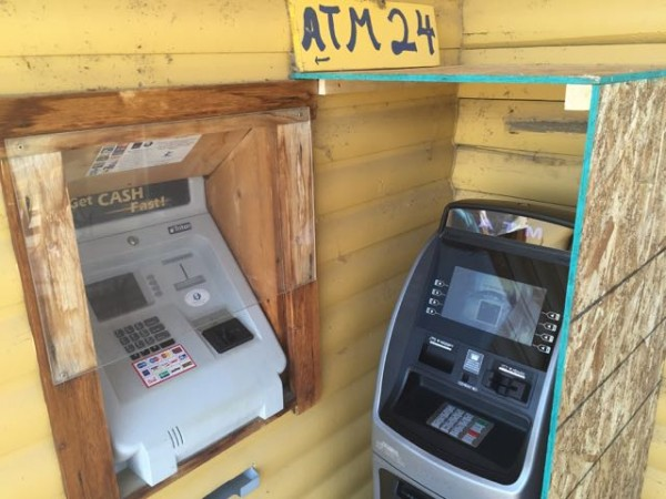 The coffeshop had dueling ATM's.
